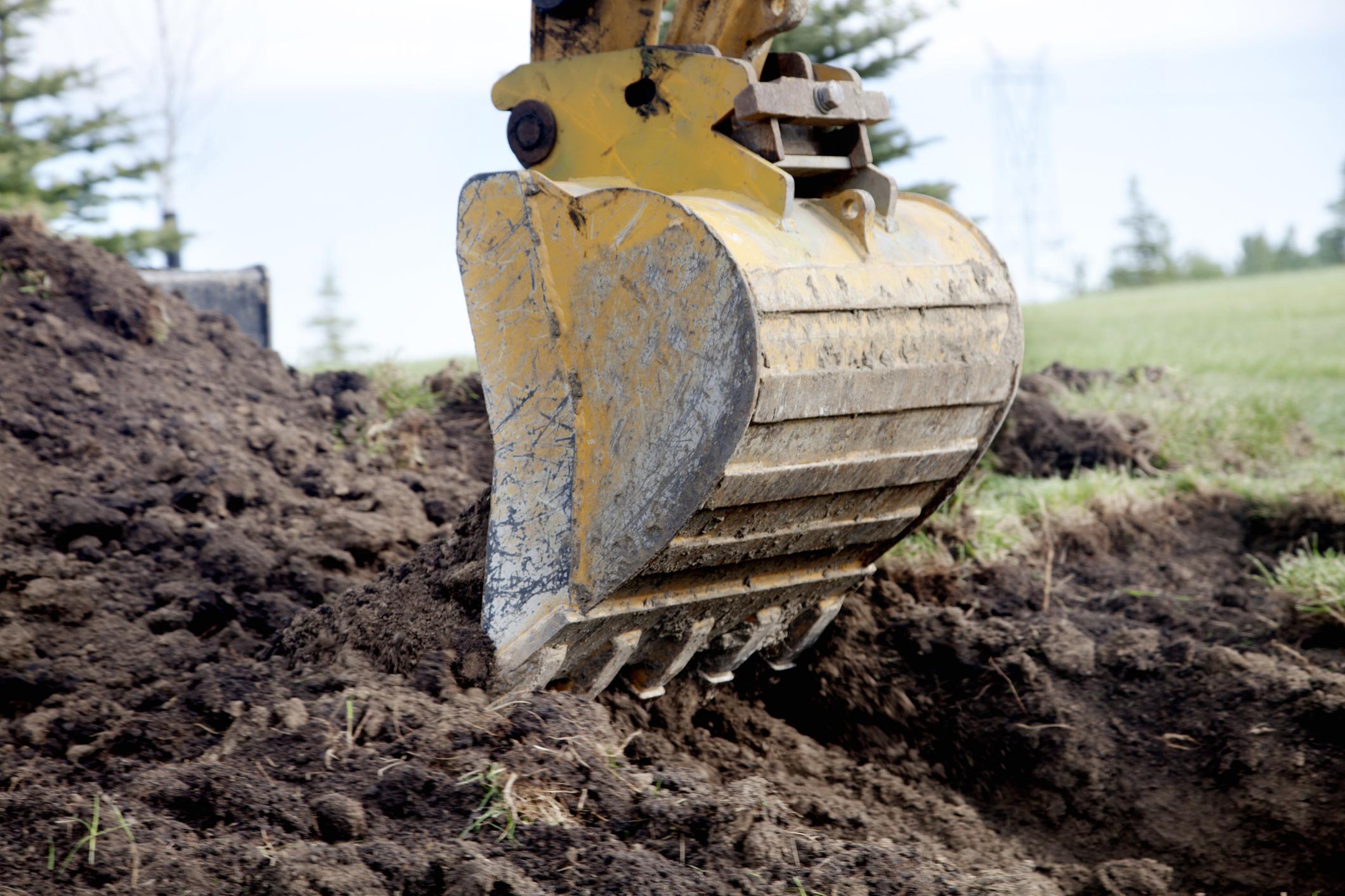 PHC0521_backhoe-digging-trench.jpg
