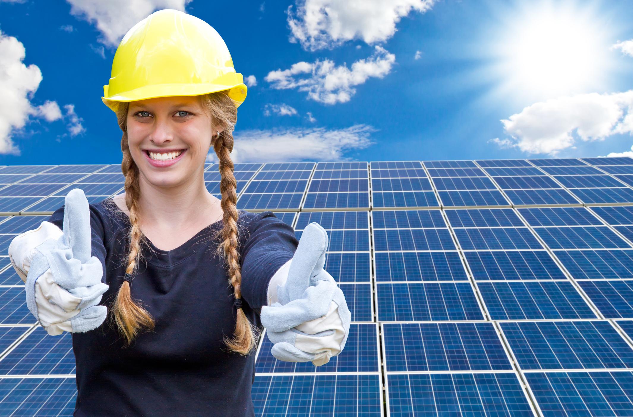 PHC0521_student-with-solar-panels.jpg