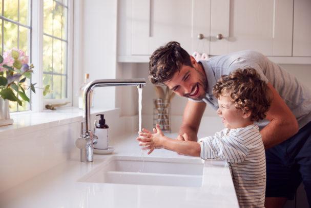PE1021_dad-son-using-kitchen-faucet.jpg