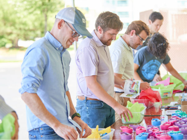 AD Associates Build, Donate Over 1,000 Boxes of Toys