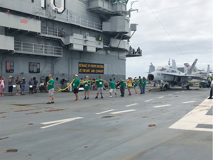 LimRic Plumbing, Heating & Air Competes in Plane Pull Abroad USS Yorktown